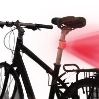 Designed with a curved back to fit snugly against rounded bike surfaces, this LED and Gear Tie Reusable Rubber Twist Tie combination can be used to light a bike for fun or safety.