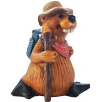 An enthusiastic, smiling hiking beaver takes hiking seriously. A full colour tabletop ceramic figurine.